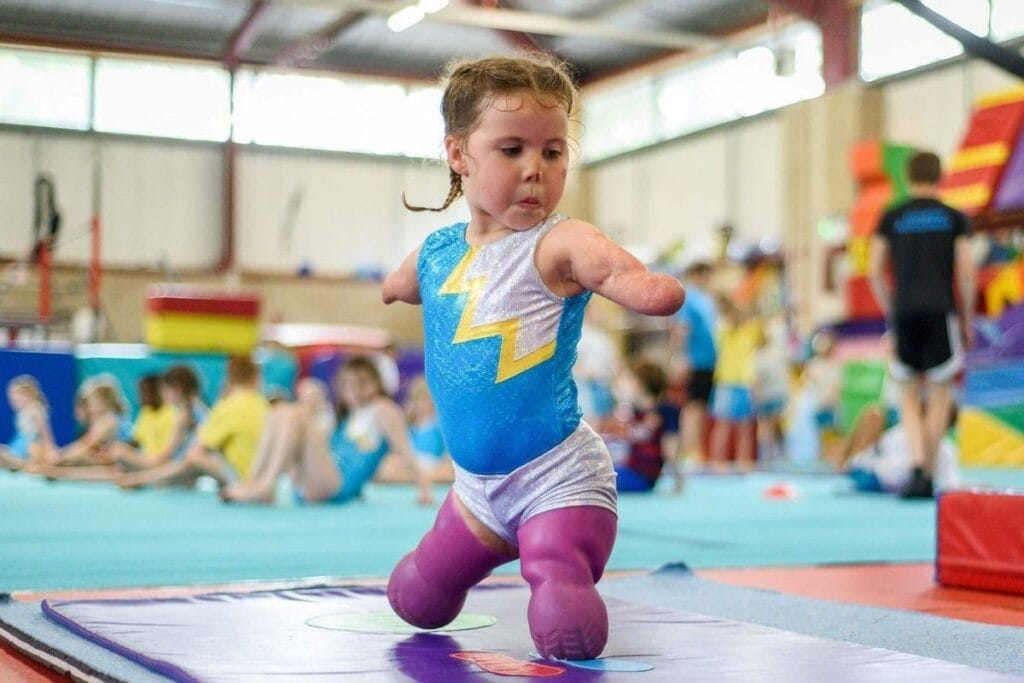 6-year-old girl, who lost her limbs to meningitis at 9-months-old, learns gymnastics.