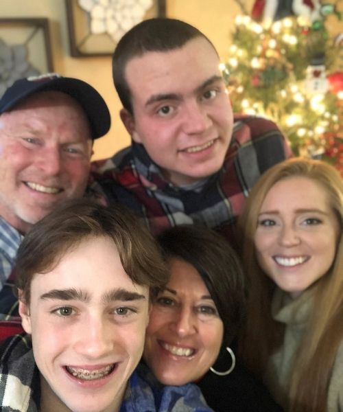 Ryan is seen in this photo with his parents, Tracy and Rob Lowry and siblings Madison Lowry, 26 and Carson, 14.