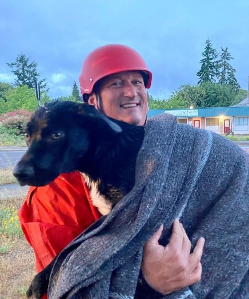 Oregon firefighters rescue injured dog from drowning and reunite the pup with his owners.
