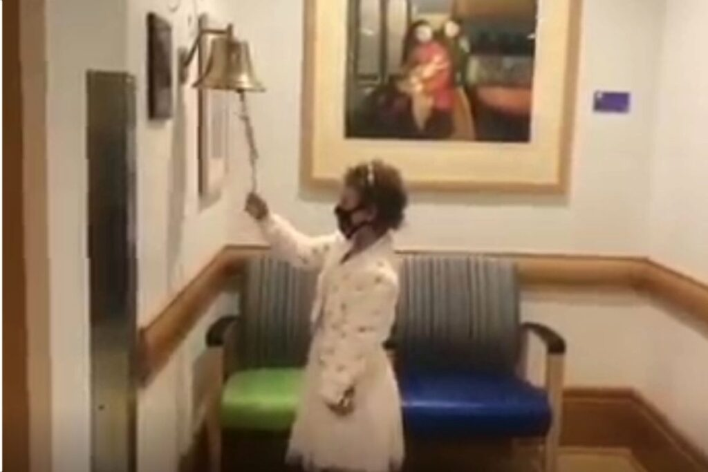 Little girl rings the victory bell after beating leukemia